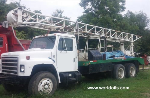 Failing 1250 Drill Rig & Water Truck for Sale